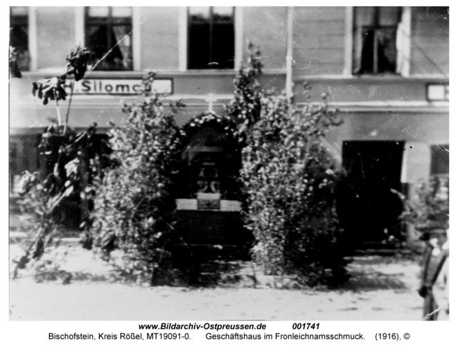 Bischofstein, Geschäftshaus im Fronleichnamsschmuck