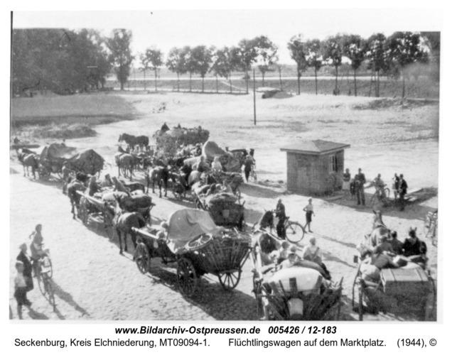 Seckenburg,  Flüchtlingswagen auf dem Marktplatz