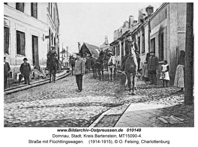Domnau, Straße mit Flüchtlingswagen